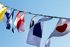 Different country flags weawing on a rope. Royalty Free Stock Photo