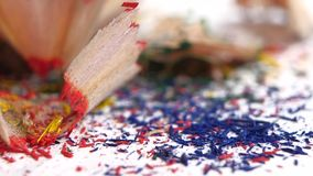 Different crayon shavings isolated on white, close stock video footage