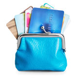 Different credit cards in purse isolated on white Stock Photography