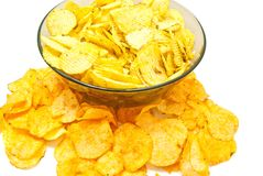 Different crispy potato chips closeup. Different potato chips on white background closeup royalty free stock photo
