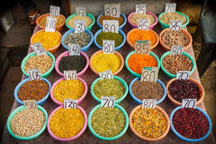 Different crops in bowls with prices. Variety of dal and crops in Indian market Royalty Free Stock Images