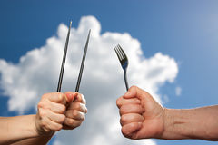 Different cultures, different cutlery. Closeup royalty free stock images