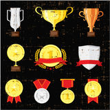 Different cups set on black background. Golden, silver and bronze trophies. Stock Images