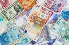 Different currencies banknotes background Royalty Free Stock Photos