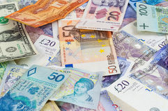 Different currencies banknotes background Stock Images
