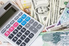 Different currencies and calculator Stock Photo
