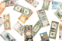 Different currencies falling down Royalty Free Stock Images