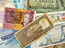 Different currency banknotes. Pile of different currency banknotes from various countries around the World Stock Image