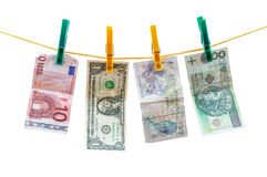 Different currency banknotes hanging on clothesline Stock Photography
