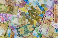 Different currency bills creating a colorful background. Money from different countries Royalty Free Stock Images