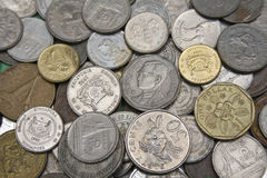 Different currency coins Stock Photos