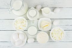 Different dairy products on the white wooden background Royalty Free Stock Photos