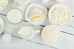 Different dairy products on the white wooden background Royalty Free Stock Photo