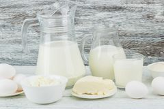 Different dairy products on the wooden background Royalty Free Stock Images