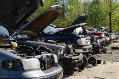 Different damaged cars on a junk yard Royalty Free Stock Photo