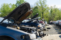 Different damaged cars on a junk yard Stock Photos