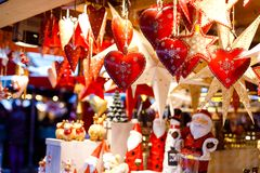 Different decoration, toy for xmas tree on christmas market, close up of cozy handmade hearts stock photos