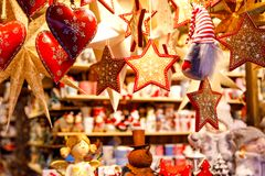 Different decoration, toy for xmas tree on christmas market, close up of cozy handmade hearts stock image