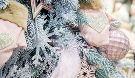 Different decorative Christmas-tree toys close-up, decorations for Christmas. Tree, green spruce branch needles. Winter Christmas New Year background royalty free stock photo