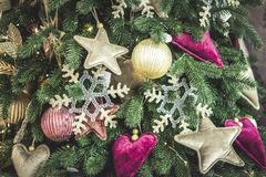 Different decorative Christmas-tree toys close-up, decorations for Christmas. Tree, green spruce branch needles. Winter Christmas New Year background stock images