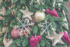 Different decorative Christmas-tree toys close-up, decorations for Christmas. Tree, green spruce branch needles. Winter Christmas New Year background royalty free stock photos