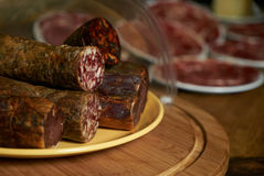 Different delicacy salami Royalty Free Stock Images