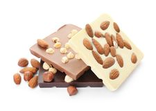 Different delicious chocolate bars with nuts. On white background Stock Images