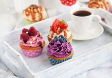 Different delicious cupcakes and coffee cup Stock Photo