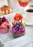 Different delicious cupcakes and coffee cup Royalty Free Stock Photo