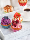Different delicious cupcakes and coffee cup Stock Photos