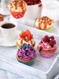 Different delicious cupcakes and coffee cup Royalty Free Stock Images