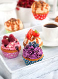 Different delicious cupcakes and coffee cup Royalty Free Stock Image