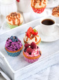 Different delicious cupcakes and coffee cup Royalty Free Stock Photos