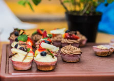 Different delicious cupcakes decorated with caramel and fresh berries Stock Images