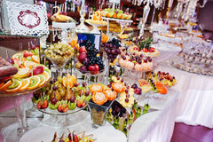 Different delicious fruits on wedding reception table. Royalty Free Stock Photography