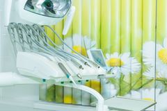Different dental instruments and tools in a dentists office. The modern white office of a dentist stock photo