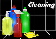 Different detergents against the black tiles. Royalty Free Stock Image