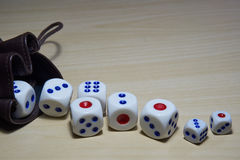 Different dices laying on the wooden table. Royalty Free Stock Photos