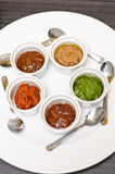 Different dips on a white plate Stock Image