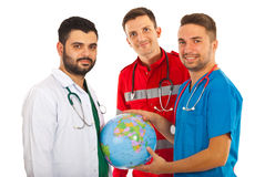 Different doctors with world globe Royalty Free Stock Photos