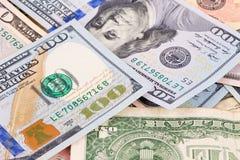 Different dollar bills. Stock Photos