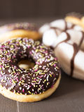 Different donuts on a wood table Royalty Free Stock Photos