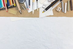 Different drawing supplies on desk, top view Royalty Free Stock Photos