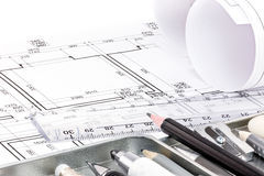 Different drawing tools for designer on architectural drawing of Royalty Free Stock Image