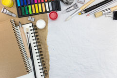 Different drawing tools on recycled paper background Royalty Free Stock Images
