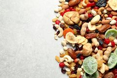 Different dried fruits and nuts on color background. Top view. Space for text royalty free stock photography