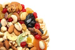 Different dried fruits and nuts on white, closeup. Space for text. Different dried fruits and nuts on white background, closeup. Space for text stock images
