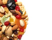 Different dried fruits and nuts on white background, closeup. Space for text stock photo