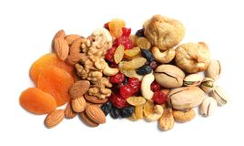 Different dried fruits and nuts on white background. Top view royalty free stock photo