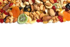 Different dried fruits and nuts on white, top view. Space for text. Different dried fruits and nuts on white background, top view. Space for text royalty free stock photos